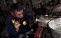US Navy 110401-N-QP268-049 Senior Chief Ron Shasky inspects a lube oil strainer for the starboard main reduction gear aboard USS Whidbey Island (LS.jpg