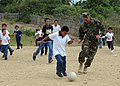 US Navy 110524-N-NY820-476 Senior Chief Master-at-Arms Gerald Rainford plays soccer at a school in Manta, Ecuador, during a community service event.jpg