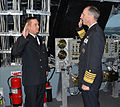 US Navy 111019-N-FC670-290 Chief of Naval Operations (CNO) Adm. Jonathan Greenert reenlists Chief Quartermaster Tyler Smith, from Eugene, Ore.jpg