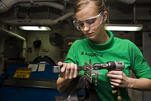 US Navy 120102-N-RJ456-017 A Sailor puts rivets into testing material.jpg