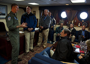 US Navy 120128-N-FI736-141 Rear Adm. Walter E. Carter, commander of Carrier Strike Group (CSG) 12, speaks to visitors during a tour aboard the airc.jpg