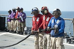 US Navy 120208-N-KS651-300 Sailors participate in a flight deck fire fighting drill aboard the amphibious dock landing ship USS Pearl Harbor (LSD 5.jpg