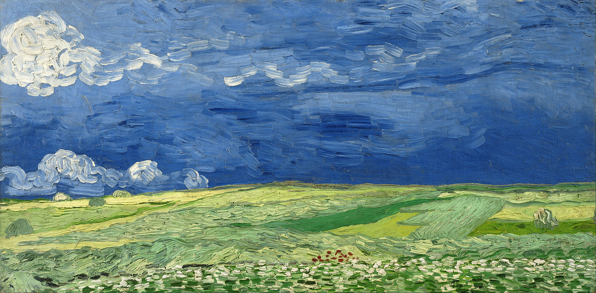 An expansive painting of a wheatfield, with green hills through the centre underneath dark and forbidding skies.