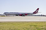 Virgin Atlantic (G-VSSH) Airbus A340-642 taxiing to Echo holding point at Sydney Airport (1).jpg