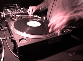 Rave - Rave music is usually presented in a DJ set, using a mixer and turntables or CDJs