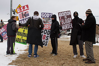 Michael Sam - Members of the Westboro Baptist Church protest Sam and the University of Missouri.
