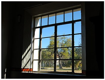 View out a window from a darken room. Fort Sam...