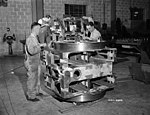 Work on brass bearing for multiple (4) 2-pounder pompom guns at Dominion Engineering Works 1942 LAC 3196179.jpg