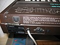 Yamaha DX7 rear left - power switch, cautions, product plate, power line & fuse.jpg