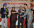 (Smt.) D. Purandeswari presenting the EPCES Export Award to the Managing Director Ms Raghvani Textiles Pvt. Ltd., Shri Karim Karmali, at a function, in New Delhi on September 30, 2013.jpg