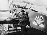 Александр Тимофеевич Кожевников у своего самолёта.jpg