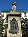 047 Font de la plaça dels Màrtirs (Vic), relleu dels sants màrtirs Llucià i Marcià.jpg