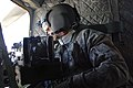 101st Airborne soldier looking out of CH-47 over Bagram Defense.gov photo essay 090215-A-2927M-040.jpg