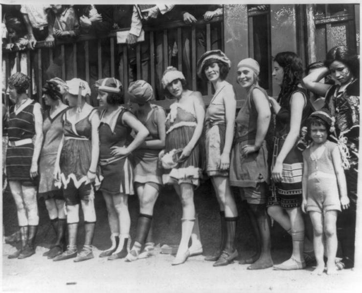 File:11 women and a little girl lined up for bathing beauty contest.png