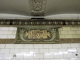 "157th Street (IRT Broadway–Seventh Avenue Line) - Ceramic cartouche with number ""157"""