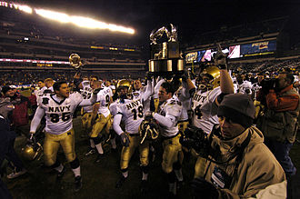 Navy Midshipmen - Navy celebrates winning the Commander-in-Chief's Trophy after winning the 2005 Army–Navy Game on December 3, 2005.