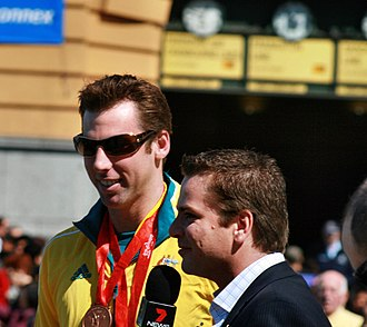 Grant Hackett - Hackett (left) at the Melbourne homecoming parade for 2008 Olympic Team