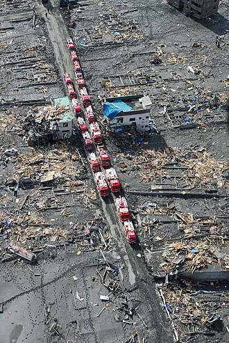 Aftermath of the 2011 Tōhoku earthquake and tsunami - A convoy of fire engines in the tsunami zone