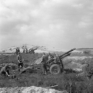 West Somerset Yeomanry - 25 pounders of 55th Field Regiment, near Hechtel in Belgium, firing in support of Guards Armoured Division in the bridgehead over the Maas-Schelde (Meuse-Escaut) Canal, 16 September 1944