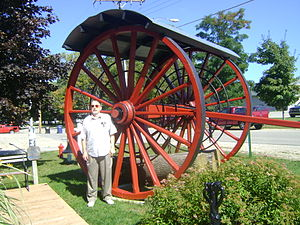 Michigan logging wheels - Eleven foot logging wheels  compared to 6 foot person