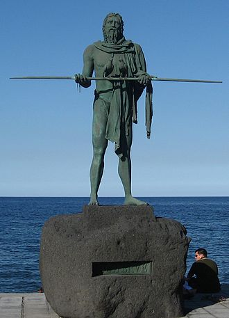 "Candelaria, Tenerife - A statue of the Guanche chief (""mencey"") Añaterve. At his side there are eight more statues."