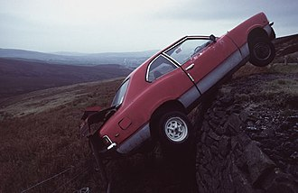 Snake Pass - An abandoned car left hanging off the edge of Snake Pass, 1983