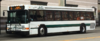 AC Transit bus #1455 operating on the 18 line at its 20th and Broadway stop.