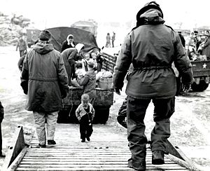 Russell L. Blaisdell - Image: A Korean toddler climbs the boarding ramp onto a C 54 at Kimpo