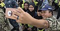 A Sailor takes a photo with Malaysian children. (40848980184).jpg
