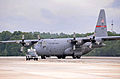 A U.S. Air Force C-130 Hercules aircraft assigned to the 165th Airlift Wing (AW), Georgia Air National Guard arrives at Dobbins Air Reserve Base, Ga., June 6, 2013, with directional assistance from a 94th 130606-F-AC256-028.jpg