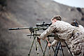 A U.S. Marine Corps scout sniper with Weapons Company, 1st Battalion, 1st Marine Regiment, 1st Marine Division conducts a known and unknown distance range with Canadian and New Zealand service members during 130612-M-SF473-027.jpg