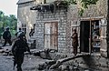 A boy in the Khogyani district of Nangarhar province, Afghanistan, watches as Afghan National Army Special Forces commandos secure buildings during a clearing operation Aug. 21, 2013 130821-A-RE111-658.jpg