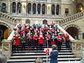 A choir of Natural History Museum, Science Museum and Victoria and Albert Museum staff members sing carols in the central hall of the Natural History Museum 02.jpg
