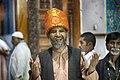 A deaf and dumb person since birth at Tomb of Lal Shahbaz Qalandar.jpg