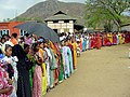 A long queue of women waiting to cast their votes during the Assam Assembly Election-2006 at Boonda Polling Station, in Guwahati on April 03, 2006.jpg