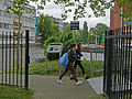 A photo of two students, walking on the university campus Roeterseiland, Amsterdam; high resolution image by FotoDutch in June 2013.jpg