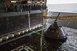 A test version of the Orion crew module has been tethered and pulled into the well deck of the USS San Diego using a winch system during the second day of Underway Recovery Test 5 (30660444256).jpg