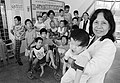 A vietnamese Professor is pictured with a group of handicapped children.jpg