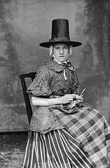 A woman in national dress and knitting (S A Jones)