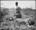 A young American lieutenant, his leg burned by an exploding Viet Cong white phosphorus booby trap, is treated by a medic - NARA - 541863.tif