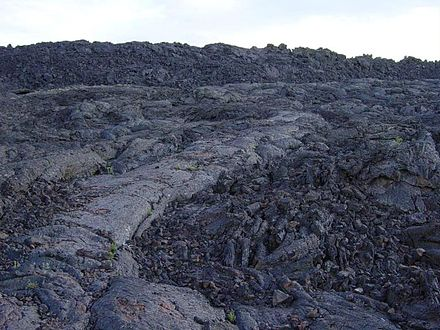 `A`a next to pahoehoe lava at the Craters of the Moon National Monument and Preserve, Idaho, United States. Aa next to pahoehoe lava at Craters of the Moon NM-750px.JPG