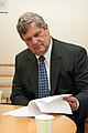Agriculture Secretary Tom Vilsack reviews notes before making opening remarks at the G-8 International Conference on Open Data for Agriculture in Washington, D.C. on Monday, Apr. 29, 2013.jpg