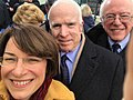 Amy Klobuchar selfie with Senators McCain and Sanders during 2017 inauguration C2oYpO6XcAArD5E.jpg