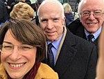 Amy Klobuchar selfie with Senators McCain and Sanders during 2017 inauguration C2oYpO6XcAArD5E.jpg
