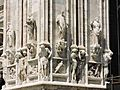 Art work on walls of Milan Cathedral Italy.jpg