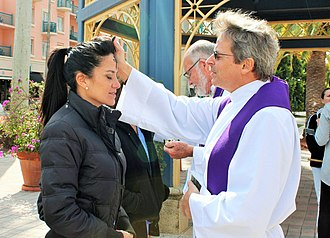 Ash Wednesday - Two Anglican priests distribute ashes to passerby in the American city of Boca Raton as part of the Ashes to Go movement