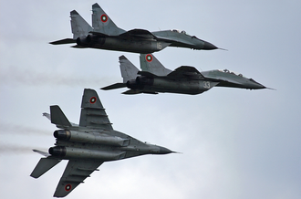 Mikoyan MiG-29 jet fighters of the Bulgarian Air Force BAF MiG-29s in flight Garchev.png