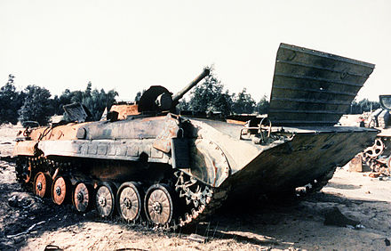 Iraqi BMP-1 in a field after being hit several times and burnt out during Operation Desert Storm, 1 February 1991.