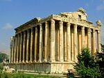 Fairly well preserved classical building surrounded by columns.