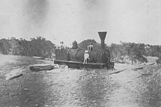 "History of rail transport in Australia - The locomotive ""Ballarat"" in the sand at Wonnerup, 1921. Reputed to be the oldest in Western Australia, the engine now sits in St Marys Park, Busselton."